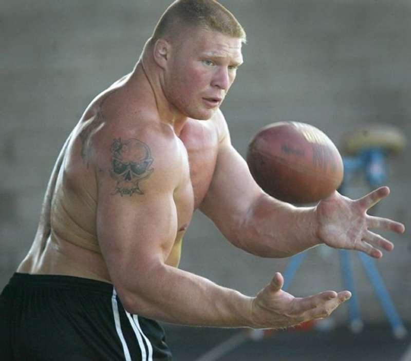 Brock Lesnar catches a football. He spent his time in between the WWE and UFC trying out to be a professional NFL player.