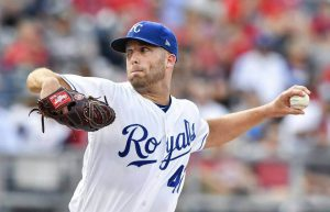 danny duffy delivers a pitch in a home game for the kansas city royals