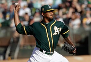 Oakland Athletics pitcher Edwin Jackson throws to a Detroit Tigers batter during the first inning of a baseball game in Oakland, Calif., Saturday, Aug. 4, 2018