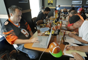 a live fantasy football draft with friends