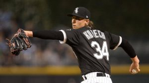 michael kopech delivers a pitch for the chicago white sox in their home ballpark