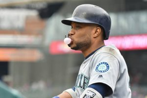 robinson cano blows a bubble on the dugout steps