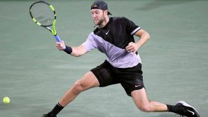 Jack Sock dashes for a ball