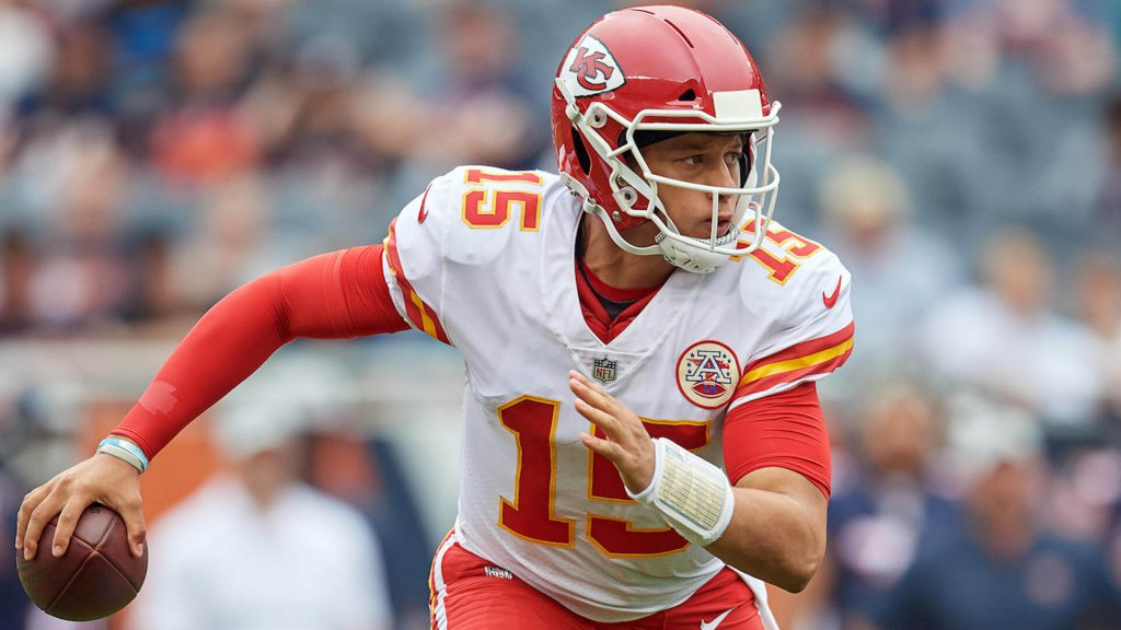 Patrick Mahomes rolls to his right during an nfl contest