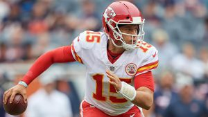 Patrick Mahomes rolls to his right during an nfl contest and is one of the top picks for your daily fantasy lineup