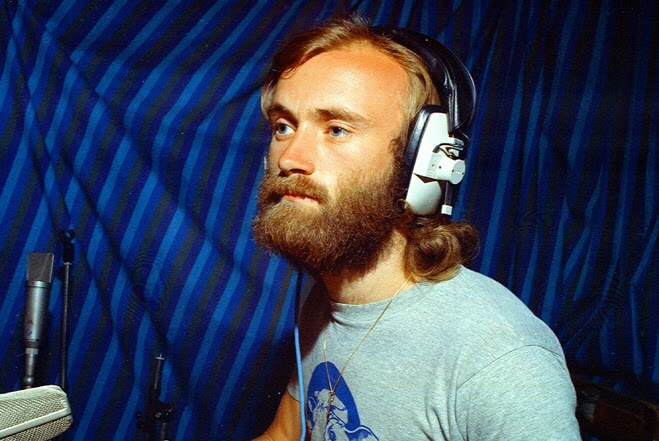Phil Collins in the studio wearing headphones in the 1970s