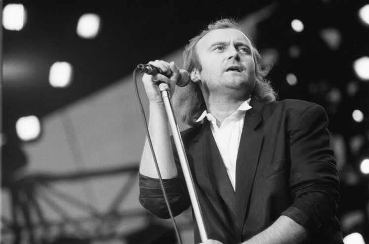 Phil Collins rocking the stage as a lead singer for Genesis in the 1980s.