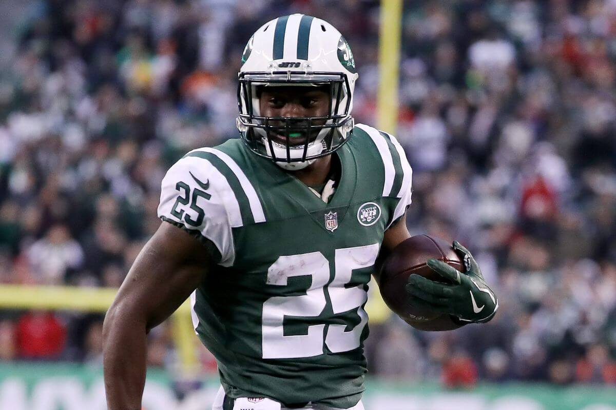 Elijah McGuire carries the ball for the Jets. McGuire is one of our sneaky under-the-radar picks for your daily fantasy lineup in week 12