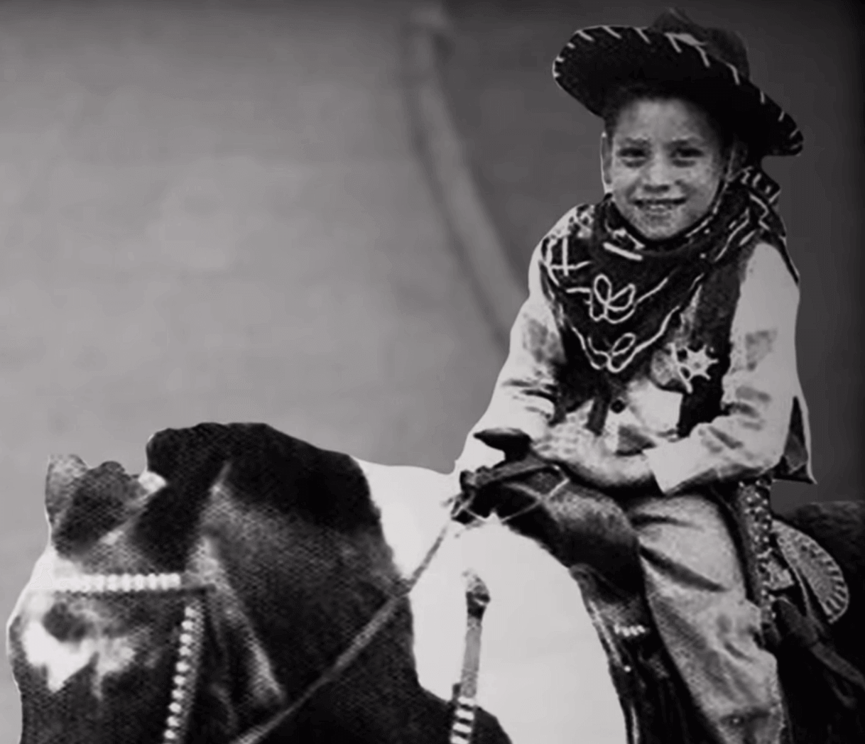 Danny Trejo as a child riding a horse.