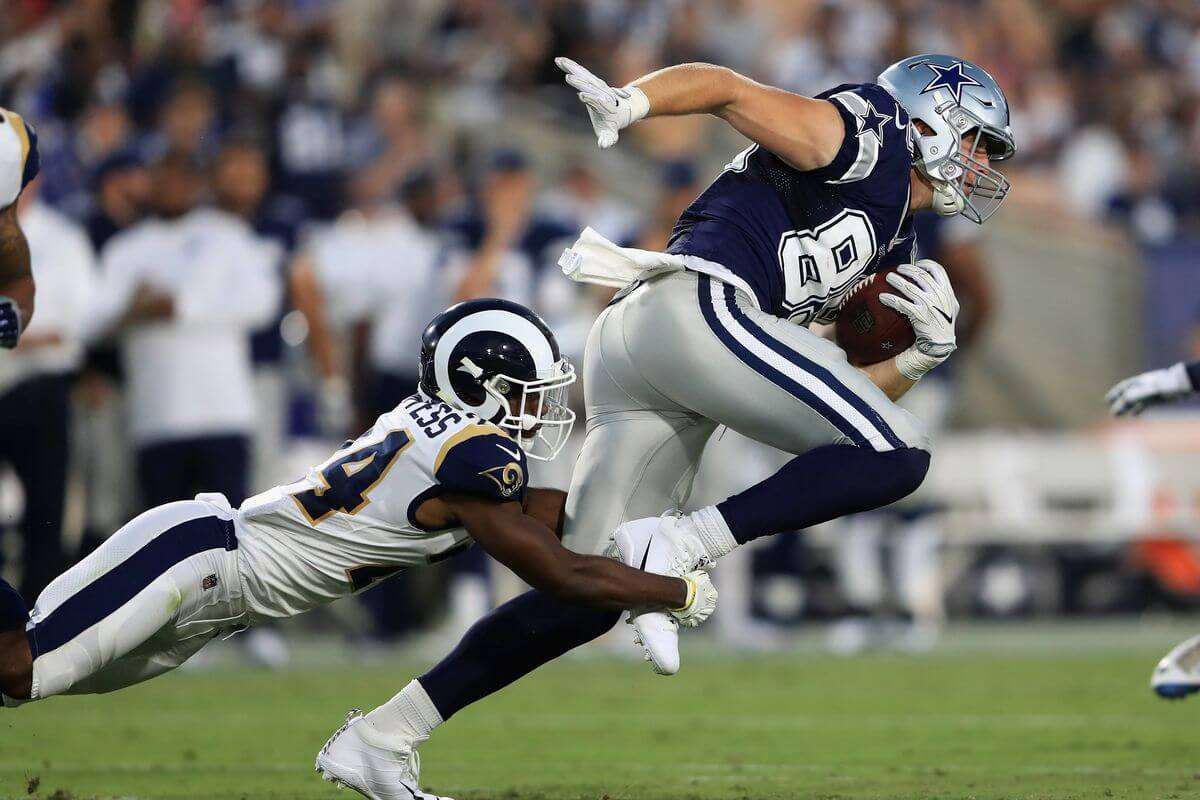 Blake Jarwin breaks free of a leg tackle against the LA Rams. Jarwin is one of our Week 16 Sneaky Plays for your daily fantasy football lineup.