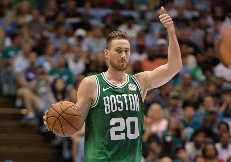 Gordon Hayward flashes a thumbs up to his teammates while dribbling during a game for the Boston Celtics. Gordon Hayward's Return to the NBA, a story by Joker Mag - the home of the underdog.