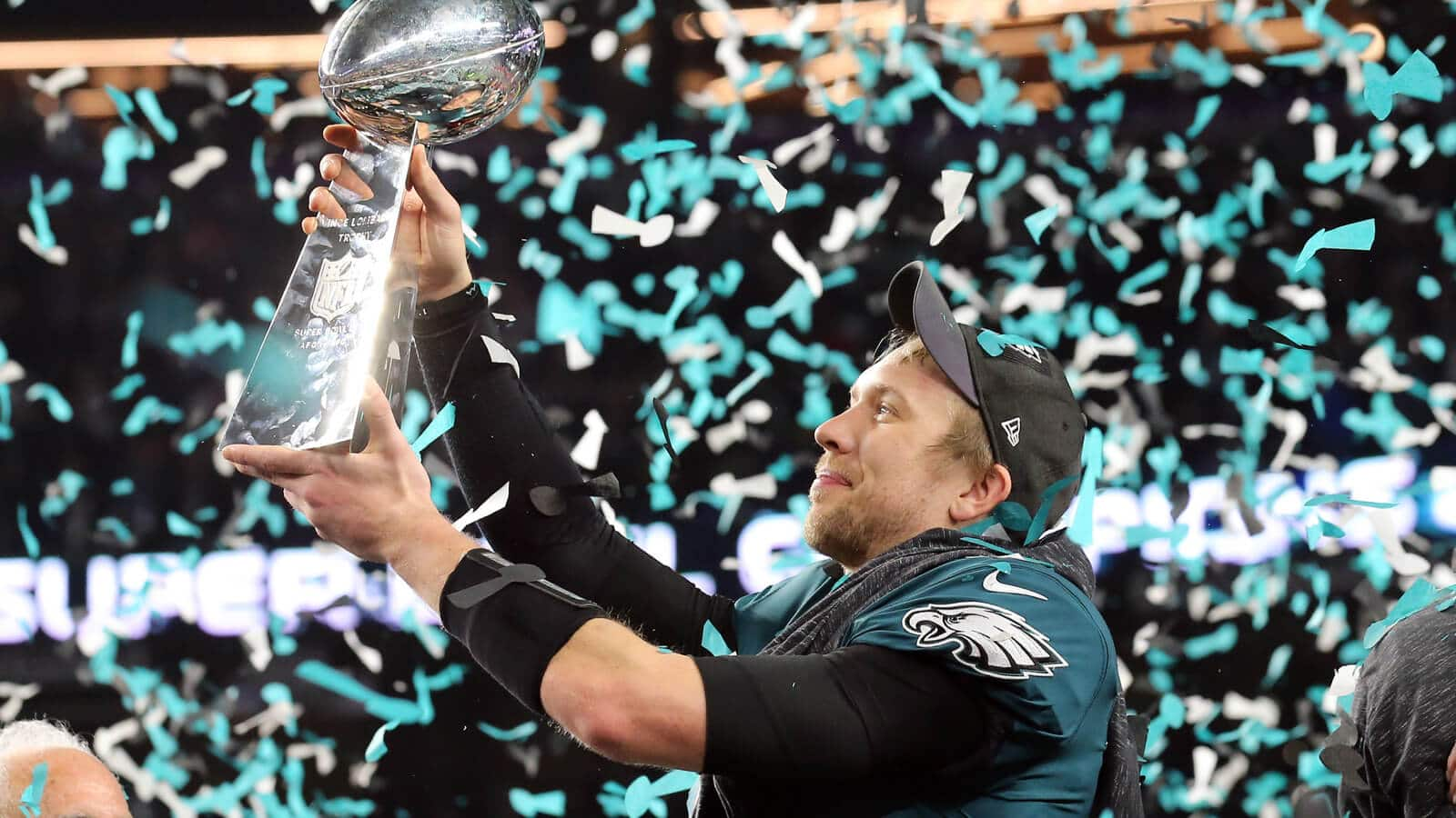 Nick Foles hoists the Super Bowl trophy after leading the Philadelphia Eagles to victory over Tom Brady and the fading New England Patriots. The Super Bowl MVP is one of our Week 15 Sneaky Plays for Your Daily Fantasy Football Lineup.