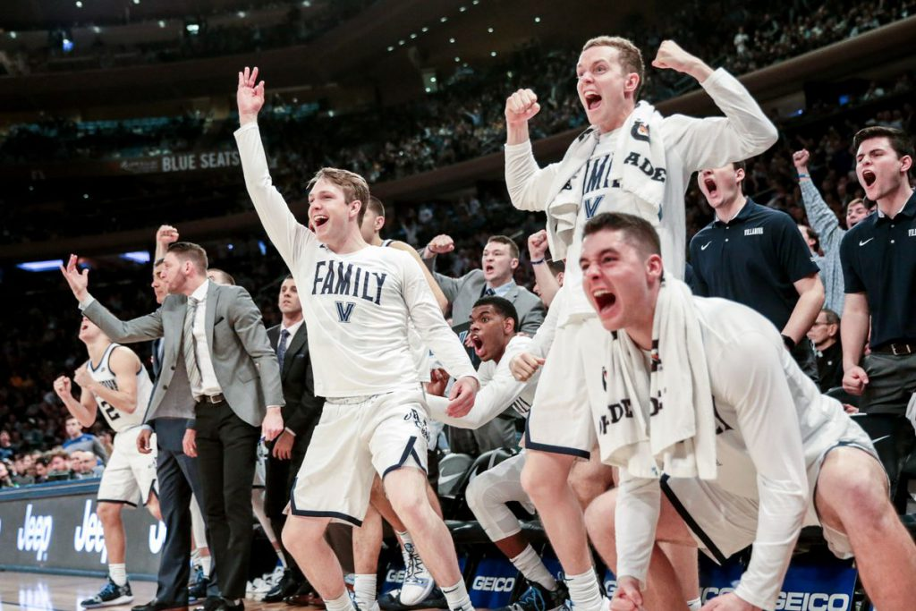 Villanova Basketball bench celebrates winning the 2019 Big East Championship. Taking a look back at the Big East realignment. Jimmy Murray celebrates in the background.