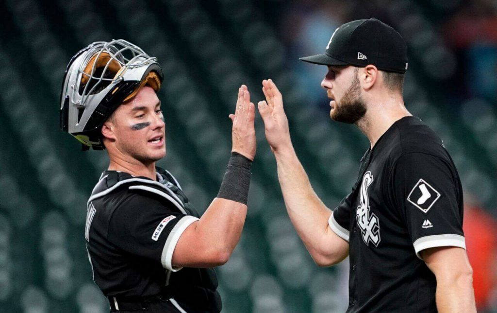 White Sox catcher James McCann high fives pitcher Lucas Giolito after another dominant outing