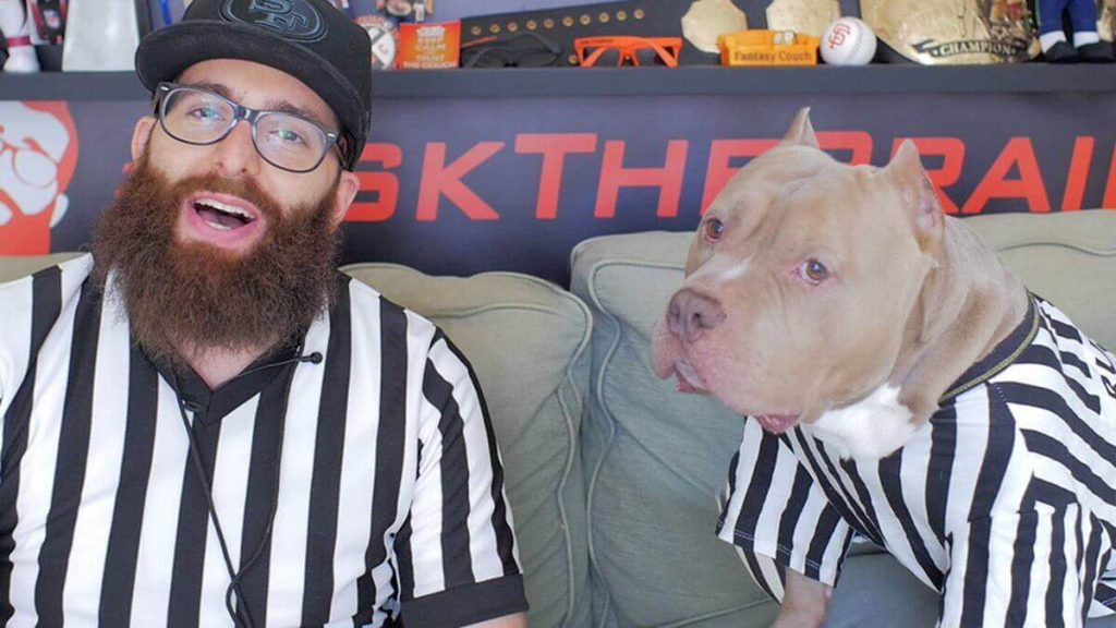 Huseyin The Brain Aksu with his dog dressed as a referee for a fantasy football YouTube video