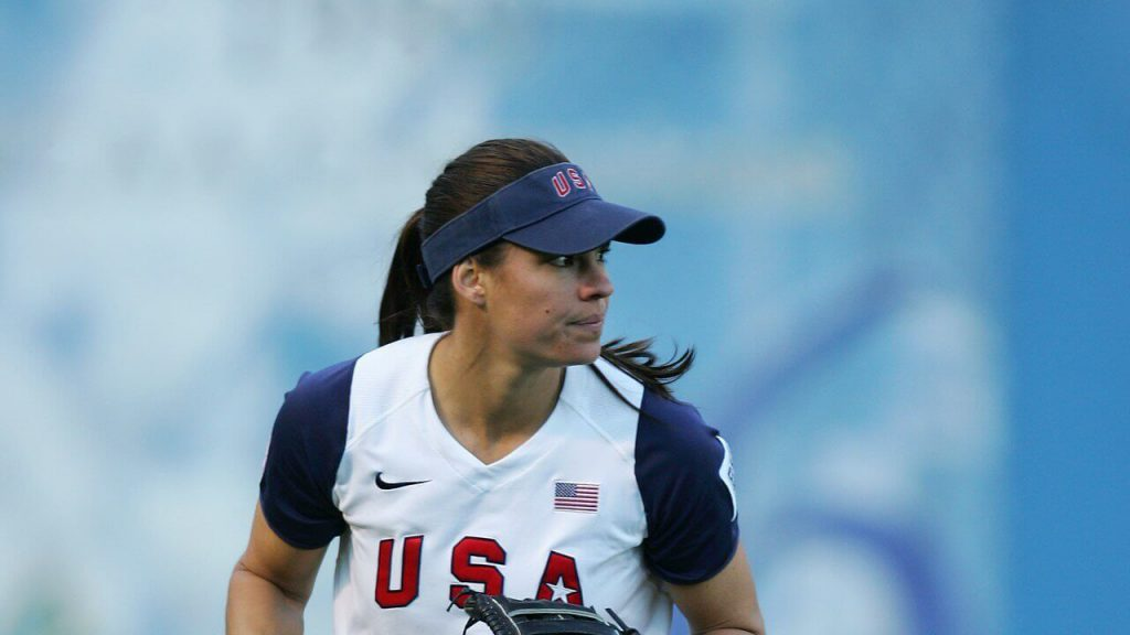Jessica Mendoza checks the runner at second from the outfield for Team USA Softball