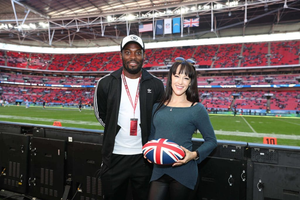 Brittany Gilman with pro soccer player Michael Essien at Wembley Stadium