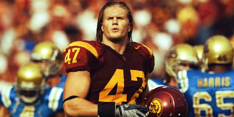 Clay Matthews removes his helmet as he leaves the field for the USC Trojans