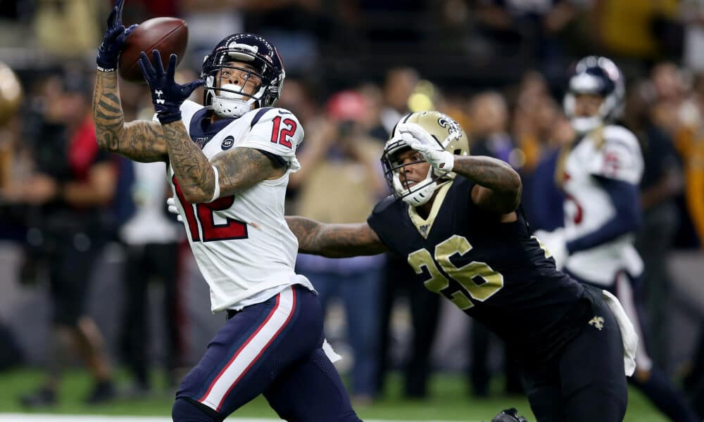 Kenny Stills snags a pass over the top of the Saints defense and safety PJ Williams during the 2019 NFL season