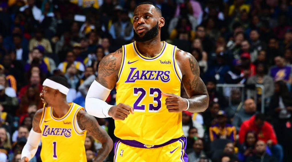 LeBron James trots down the court for the Lakers, preparing for the Battle of Los Angeles