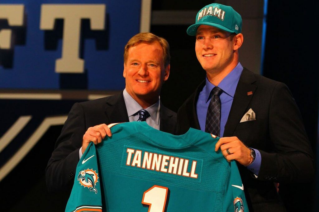 Ryan Tannehill stands on the podium with Roger Goodell at the 2012 NFL Draft