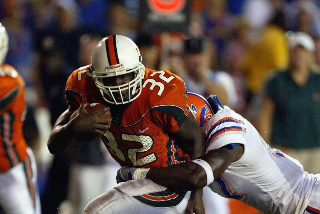 Frank Gore breaks a tackle to score a touchdown against Florida in 2003