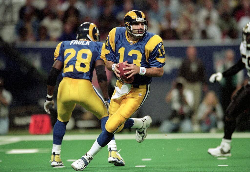 Kurt Warner rolls out of the pocket for the St Louis Rams, protected by Marshall Faulk