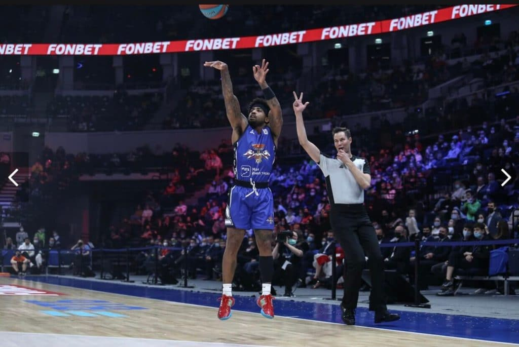 Marcus Keene pulls up for a 3 point shot in a professional basketball game overseas