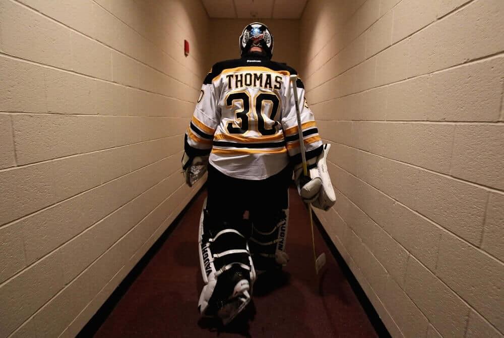 Boston Bruins goalie Tim Thomas walks through the tunnel at TD Garden